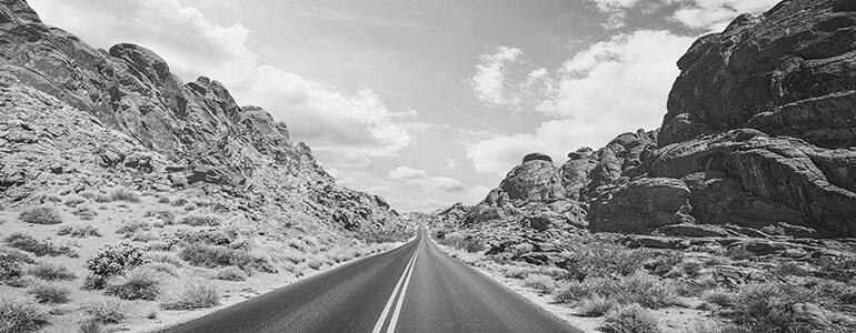 road leading to the horizon balck and white